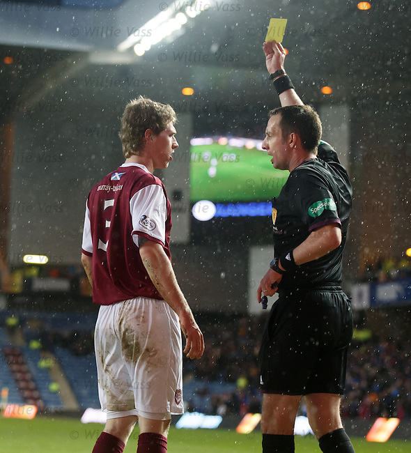 Colin Hamilton booked by referee Barry Cook for his part in the penalty kick