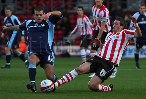 12th December 2009. Southapmton's Morgan Schneiderlin (red and white shirt) goes in for a challenge with John Welsh (11) in the first half. Division 1 match, Southampton v Tranmere Rovers, St Mary's Stadium, Southampton, Hampshire, England. Photo: Colin Read/Actionplus - Editorial Use Worldwide