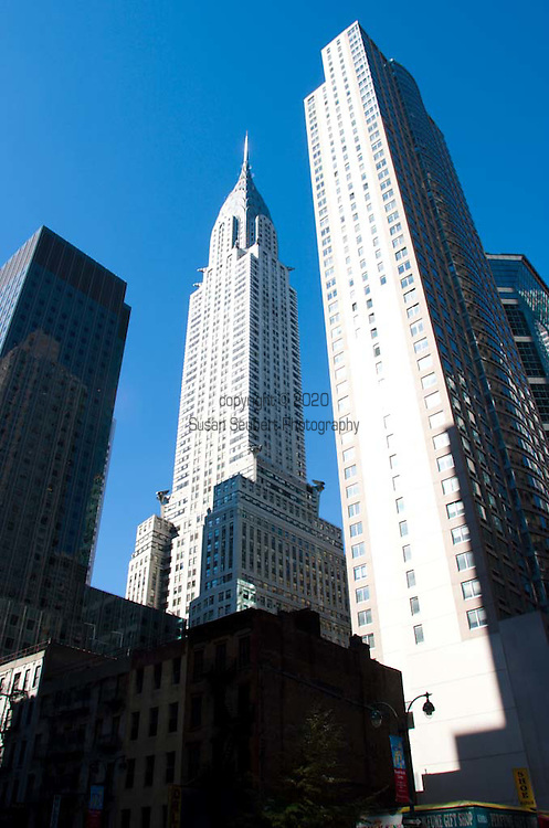 The Chrysler Building is an Art Deco skyscraper in New York City, located on the east side of Manhattan in the Turtle Bay area at the intersection of 42nd Street and Lexington Avenue. Standing at 319 metres (1,047 ft), it was the world's tallest building for 11 months before it was surpassed by the Empire State Building in 1931. However, the Chrysler Building remains the world's tallest brick building