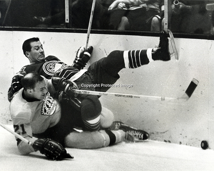 NHL hockey Nov 15,1967, Seals George Swarbrick or Aut Erickson, on top of Kings #21 Bill White .NHL hockey game in Oakland, Cal  (1967 photo/Ron Riesterer)