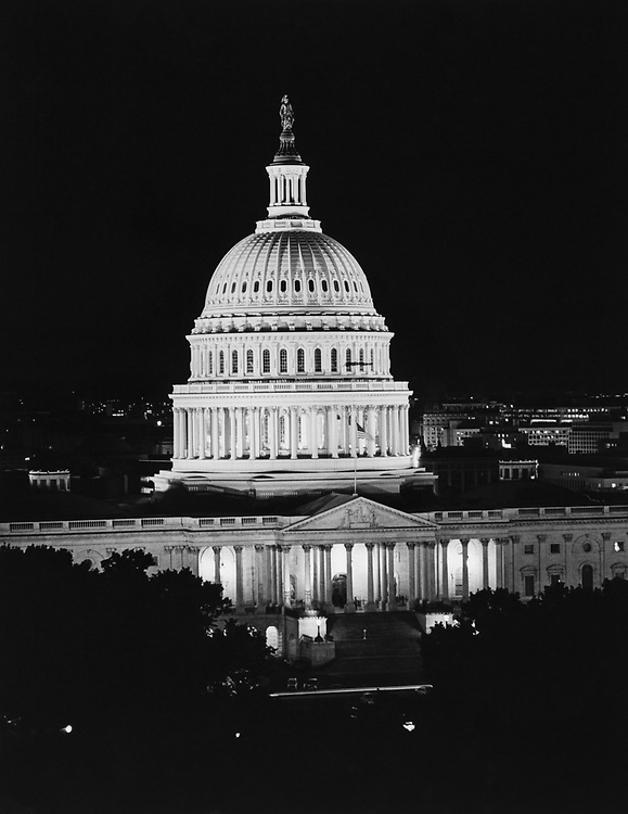 Exterior of Capitol Hill at night. (Photo by CQ Roll Call via Getty Images)