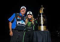 Nov 12, 2017; Pomona, CA, USA; NHRA top fuel driver Brittany Force (right) poses for a portrait with her father John Force as she celebrates after winning the 2017 top fuel world championship and the Auto Club Finals at Auto Club Raceway at Pomona. Mandatory Credit: Mark J. Rebilas-USA TODAY Sports