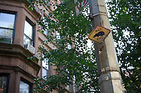 Signs for a rat crossing seen on a block in the Upper West Side neighborhood of New York on Thursday, August 30, 2012. Residents complain the rat population of the block has increased during a building renovation and the unofficial sign has been put up in frustration by a resident. (© Frances M. Roberts)
