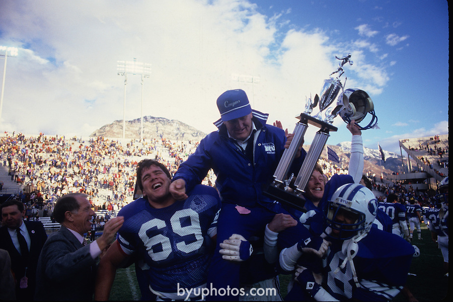 FTB 1984 994<br /> <br /> BYU vs UTep. 69 Scott Robinson Carrying Coach LaVell Edwards with Championship trophy.<br /> <br /> Photo by Mark Philbrick/BYU<br /> <br /> &copy; BYU PHOTO 2009<br /> All Rights Reserved<br /> photo@byu.edu  (801)422-7322