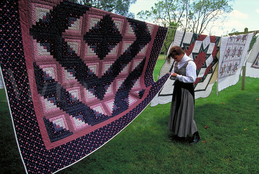 Amish traditional quilts for sale. Woman. Strasburg Pennsylvania USA Lancaster County.