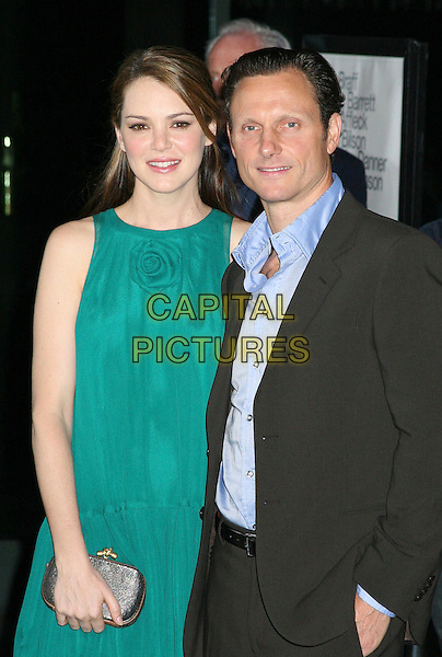 "JACINDA BARRETT & TONY GOLDWYN.Los Angeles Premiere of ""The Last Kiss"", West Hollywood, California, USA..September 13th, 2006.Ref: ADM/BP.half length turquoise sleeveless dress clutch purse grey gray suit jacket.www.capitalpictures.com.sales@capitalpictures.com.©Byron Purvis/AdMedia/Capital Pictures."