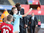 4th November 2017, Liberty Stadium, Swansea, Wales; EPL Premier League football, Swansea City versus Brighton and Hove Albion; Tammy Abraham of Swansea City takes a photo with a young fan before the game