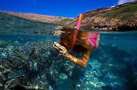 Snorkeler with underwater camera