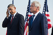 United States President Barack Obama wipes his face as he stands next to Secretary of Defense Chuck Hagel, after delivering remarks during a remembrance ceremony for the 12th anniversary of the 9/11 terrorist attacks, at the Pentagon on September 11, 2013 in Arlington, Virginia. <br /> Credit: Kevin Dietsch / Pool via CNP