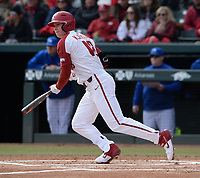 Arkansas right fielder Heston Kjerstad heads to first base Friday, Feb. 14, 2020, as he singles in left fielder Braydon Webb during the first inning against Eastern Illinois at Baum-Walker Stadium in Fayetteville. Visit nwaonline.com/200214Daily/ for today's photo gallery.<br /> (NWA Democrat-Gazette/Andy Shupe)