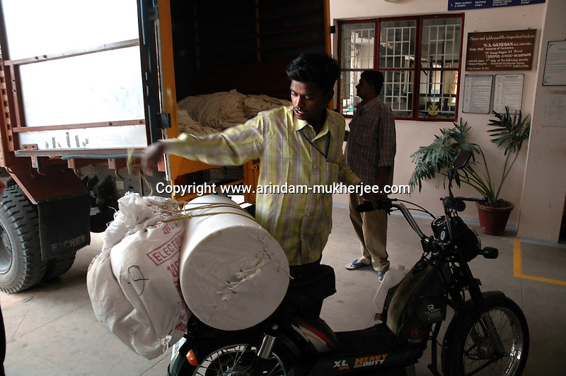 Raw materials arrived at Prime Tex garment factory in Tirupur, Tamilnadu. After lifting of quota system in textile export on 1st january 2005. Tirupur has become the biggest foreign currency earning town of India.