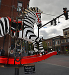 """A view of, """"Deebra at the Zoo,"""" by artist, Debra Ricks, one of the 35 Artist painted Rocking Horses on display around Saugerties, NY as part of the Chamber of Commerce sponsored Art in the Village Project titled """"Rockin' Around Saugerties."""" This photo taken on Friday, May 26, 2017. Photo by Jim Peppler. Copyright/Jim Peppler-2017."""