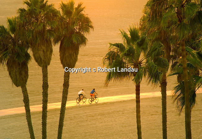 A couple rides along the bike path on Santa Monica Beach