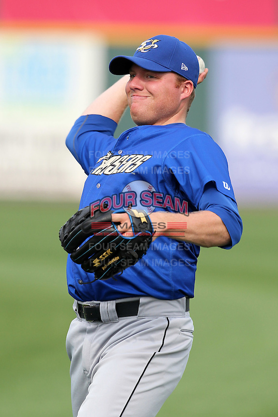 Omaha Storm Chasers pitcher Kevin Pucetas #26 throws in the outfield during batting practice before a game against the Nashville Sounds at Greer Stadium on April 25, 2011 in Nashville, Tennessee.  Omaha defeated Nashville 2-1.  Photo By Mike Janes/Four Seam Images