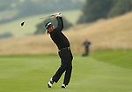 Spanish golfer Miguel Angel Jimenez hits his approach to the 18th during the first round of the ISPS Handa Wales Open 2013 at the Celtic Manor Resort<br /> <br /> 29.08.13<br /> <br /> ©Steve Pope-Sportingwales