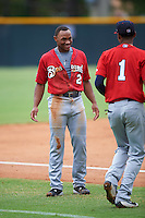 Brevard County Manatees center fielder Corey Ray (2) talks with Jose Cuas (1) in between innings during a game against the Lakeland Flying Tigers on August 8, 2016 at Henley Field in Lakeland, Florida.  Lakeland defeated Brevard County 6-2.  (Mike Janes/Four Seam Images)