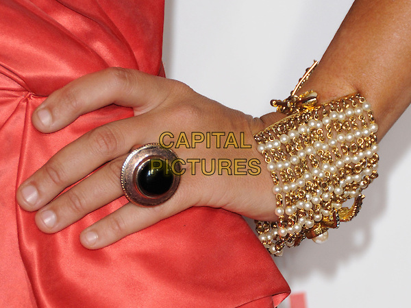 "LADY VICTORIA HERVEY's hand .Attends the AFI Fest 2010 Screening of ""The King's Speech"" held at The Grauman's Chinese Theatre in Hollywood, California, USA,.November 5th 2010..detail ring gold black stone bracelet jewellery jewelry pearls                          .CAP/RKE/DVS.©DVS/RockinExposures/Capital Pictures."