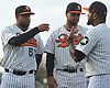 Newly signed Long Island Ducks pitcher Francisco Rodriguez #57, left, and Carlos Pimentel #26, center, greet teammate Jordany Valdespin #15 during pregame introductions that preceded the team's season home opener against the Southern Maryland Blue Crabs at Bethpage Ballpark in Central Islip, NY on Friday, May 4, 2018.