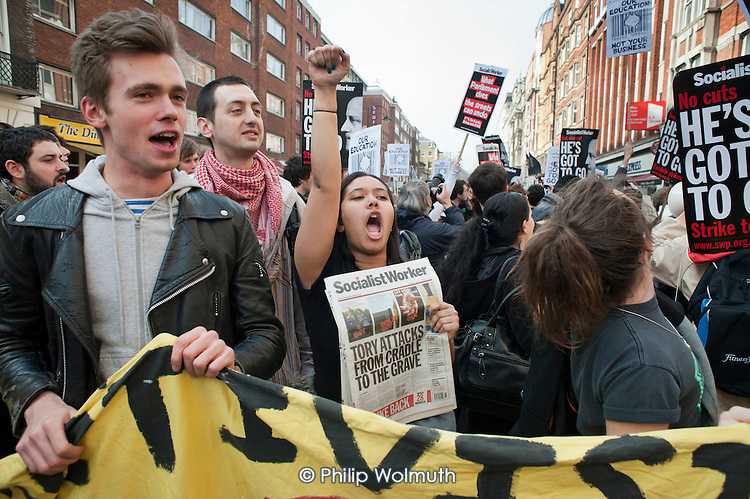 London students march during an NUS national student walk-out against fees, education cuts, and debt.