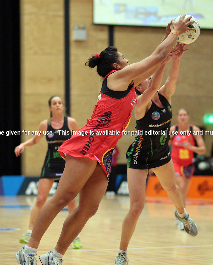 06.05.2012 Magic's Julianna Naoupu and Fever's Ashleigh Brazill in action during the ANZ Champs netball match between the Magic and Fever at the TECT Arena in Tauranga. Mandatory Photo Credit ©Michael Bradley.