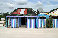 Bright paints spruce up an old building in the town of Costa Maya, Mexico..Carribean, Mexico, Costa Maya, colorful.
