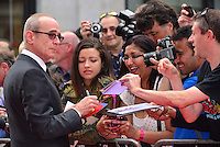Francis Rossi<br /> The &quot;Bula Quo!&quot; UK film premiere, Odeon West End cinema, Leicester Square, London, England.<br /> July 1st, 2013<br /> half length black jacket suit side profile tinted glasses fans signing autographs <br /> CAP/BF<br /> &copy;Bob Fidgeon/Capital Pictures
