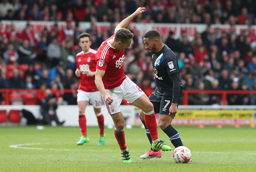 Nottingham Forest's Chris Cohen is tackled by Blackburn Rovers' Liam Feeney<br /> <br /> Photographer Rachel Holborn/CameraSport<br /> <br /> The EFL Sky Bet Championship - Nottingham Forest v Blackburn Rovers - Friday 14th April 2016 - The City Ground - Nottingham<br /> <br /> World Copyright &copy; 2017 CameraSport. All rights reserved. 43 Linden Ave. Countesthorpe. Leicester. England. LE8 5PG - Tel: +44 (0) 116 277 4147 - admin@camerasport.com - www.camerasport.com