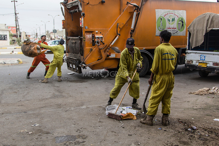 10/10/2014 -- Kirkuk, Iraq -- Bangladeshi workers clean the Rzagari neighborhood.