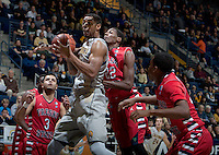 Richard Solomon of California rebounds the ball during the game against Fresno State at Haas Pavilion in Berkeley, California on December 14th, 2013.  California defeated Fresno State, 67-56.