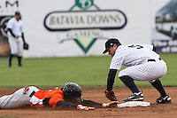 Northfolk Tides Xavier Avery makes it back safely on second base as Scranton/Wilkes-Barre Yankees Jayson Nix missed the tag in the third inning at Dwyer Stadium  in Batavia, New York on April 22, 2012.