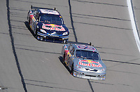 Sept. 28, 2008; Kansas City, KS, USA; Nascar Sprint Cup Series driver A.J. Allmendinger leads teammate Brian Vickers during the Camping World RV 400 at Kansas Speedway. Mandatory Credit: Mark J. Rebilas-