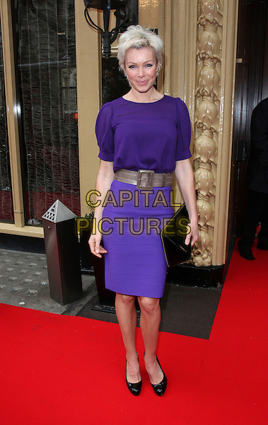 NELL McANDREW .Tesco Mum of the Year Awards at the Waldorf Hilton Hotel, London, England, March 1st 2009.full length bleached blonde hair purple top skirt waist belt black shoes clutch bag patent Christian Louboutin.CAP/ROS.©Steve Ross/Capital Pictures