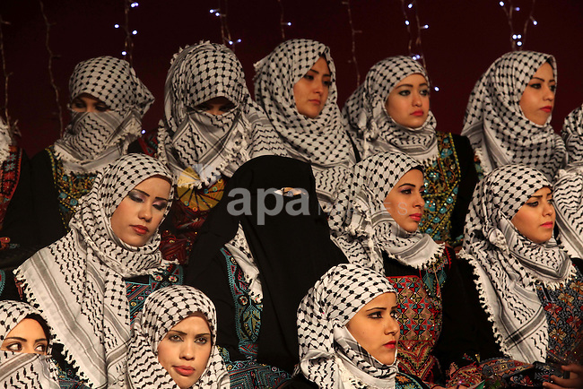 Palestinian brides take part in a mass wedding ceremony in Gaza City on February 04, 2014. Nearly 50 Palestinians were married in the Gaza Strip in a mass wedding funded by the office of Palestinian President Mahmoud Abbas. Photo by Ashraf Amra
