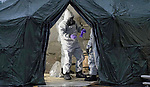 09.03.2018, Salisbury; UK: RUSSIAN SPY POISONED<br /> Soldiers in Hazmat suits check for contamination at the  Accident and Emergency entrance of Salisbury Hospital in Wiltshire.<br /> The decontamination operation is in response to the deadly nerve agent attack on Russian double agent Sergei Skripal, 66, and his daughter Yulia, 33, who remain in a 'critical condition' in hospital.<br /> Mandatory Credit Photo: Brown/NEWSPIX INTERNATIONAL<br /> <br /> IMMEDIATE CONFIRMATION OF USAGE REQUIRED:<br /> Newspix International, 31 Chinnery Hill, Bishop's Stortford, ENGLAND CM23 3PS<br /> Tel:+441279 324672  ; Fax: +441279656877<br /> Mobile:  07775681153<br /> e-mail: info@newspixinternational.co.uk<br /> *All fees payable to Newspix International*