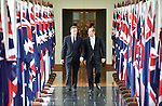 AUSTRALIA, Canberra : David Cameron Prime Minister of the United Kingdom (L), and Australian Prime Minister Tony Abbott (R) leave the House of Representatives at Parliament House in Canberra on November 14, 2014. AFP PHOTO/POOL/ MARK GRAHAM