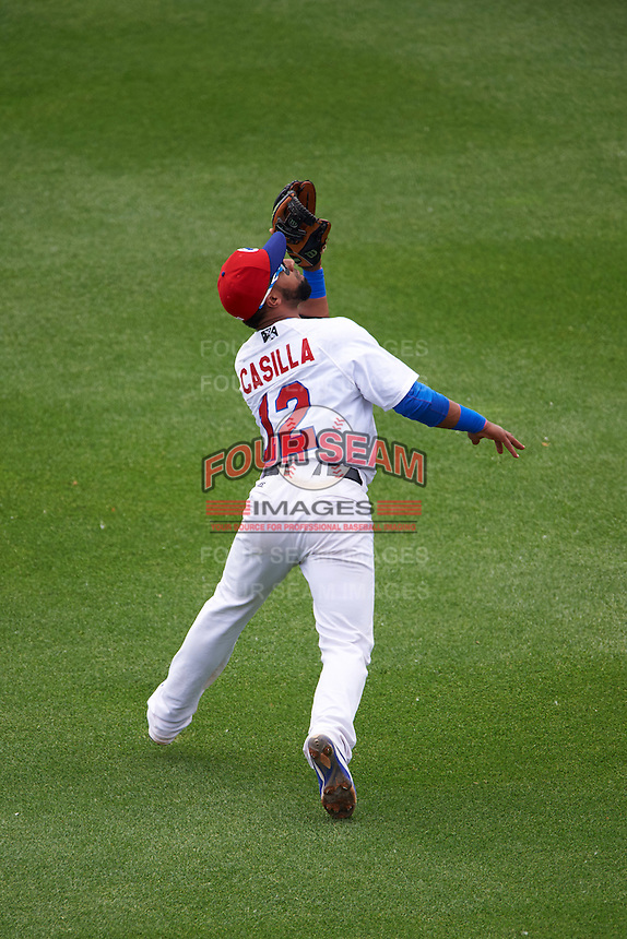 Buffalo Bisons shortstop Alexi Casilla (12) catches a popup during a game against the Louisville Bats on June 23, 2016 at Coca-Cola Field in Buffalo, New York.  Buffalo defeated Louisville 9-6.  (Mike Janes/Four Seam Images)