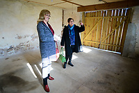 From left, Gloria Wargo of Ringoes, NJ and Karin Clements of Yardley, Pa. view one of the exterior buildings at the Bucks County Designer House Empty House Party Sunday, February 26, 2017 in Buckingham, Pennsylvania. (Photo by William Thomas Cain)