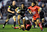 Anthony Watson of Bath Rugby takes on the Toulon defence. European Rugby Champions Cup match, between RC Toulon and Bath Rugby on January 10, 2016 at the Stade Mayol in Toulon, France. Photo by: Patrick Khachfe / Onside Images
