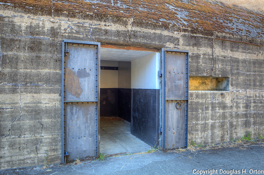 Door and Windows to an abandoned gunnery bunker at Fort Flagler, in Washington State.  Fort Flagler, along with Fort Worden on the Olympic Penninsula and Fort Carsey on Whidbey Island were established in the 1890's as a triangular guardian of the marine entrance to Puget Sound.  Fort Flagler State Park, Marrowstone Island, Washington. Represented by www.spacesimages.com Olympic Peninsula