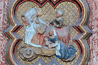 Elizabeth gives her son the name John, plaque on the North side of the Gothic choir screen, 1490-1530, commissioned by canon Adrien de Henencourt and made by the sculptor Antoine Ancquier, depicting the life of St John the Baptist, at the Basilique Cathedrale Notre-Dame d'Amiens or Cathedral Basilica of Our Lady of Amiens, built 1220-70 in Gothic style, Amiens, Picardy, France. Amiens Cathedral was listed as a UNESCO World Heritage Site in 1981. Picture by Manuel Cohen