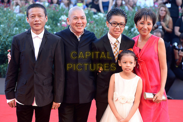 Lee Yi-cheng, Lu Yi-ching, director Ming Liang Tsai and actors Lee Kang-sheng and Lee Yi-chieh (front)<br /> attending the Closing Ceremony of the 70th Venice International Film Festival at Palazzo del Cinema in Venice, Italy, September 7th 2013.<br /> half length white dress red black suit <br /> CAP/ZZG<br /> &copy;ZZG/Capital Pictures