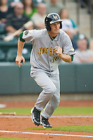Kevyn Feiner #16 of the Lynchburg Hillcats hustles down the first base line against the Winston-Salem Dash at  BB&T Ballpark May 22, 2010, in Winston-Salem, North Carolina.  Photo by Brian Westerholt / Four Seam Images