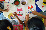 Children paint pictures during an early intervention program of Piña Palmera, a center for community based rehabilitation for people living with disabilities in Zipolite, a town in Oaxaca, Mexico.