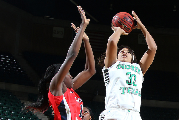 DENTON, TX - JANUARY 12: Desiree Nelson #32 of the North Texas Mean Green shoots against Meghan Dunn #1of the South Alabama Jaguars  at the UNT Coliseum on January 12, 2013 in Denton, Texas. Photo: Rick Yeatts