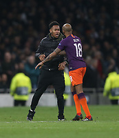 Manchester City's Fabian Delph challenges a pitch invader<br /> <br /> Photographer Rob Newell/CameraSport<br /> <br /> UEFA Champions League Quarter-finals 1st Leg - Tottenham Hotspur v Manchester City - Tuesday 9th April 2019 - White Hart Lane - London<br />  <br /> World Copyright © 2018 CameraSport. All rights reserved. 43 Linden Ave. Countesthorpe. Leicester. England. LE8 5PG - Tel: +44 (0) 116 277 4147 - admin@camerasport.com - www.camerasport.com