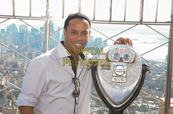 NEW YORK, NY - SEPT. 7: Ronaldinho participates in the ceremonial lighting of the Empire State Building in in honor of FC Barcelona's 10-year global partnership with UNICEF on September 7, 2016 in New York City. <br /> CAP/MPI/RH<br /> &copy;RH/MPI/Capital Pictures