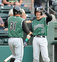 Third baseman Raynor Campbell (31) of the Augusta GreenJackets is congratulated by Bobby Haney (21) after hitting a home run in a game against the Greenville Drive on August 27, 2011, at Fluor Field at the West End in Greenville, South Carolina. (Tom Priddy/Four Seam Images)