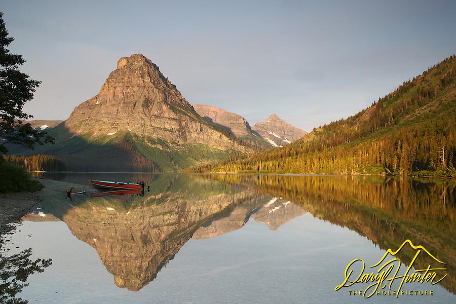 Mt. Sinopah, sunrise, red boat, Two Medicine Lake, reflection, Glacier National Park