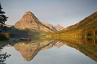 Mt. Sinopah, sunrise, red boat, Two Medicine Lake, reflection, Glacier National Park