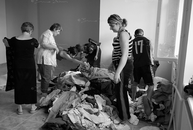 Tbilissi, Georgia; August 17, 2008.A soviet-era school is slowly being converted as a small IDP camp. IDP's choosing clothes distributed by a local charity organistaion.According to the Georgian government, 118000 people have been displaced as a result from the conflict, however relatively few stay in IDP camps as most have found refuge with relatives living out of the affected areas.